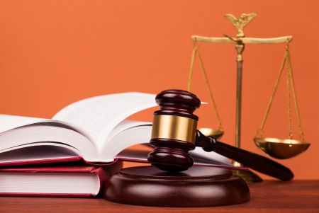 22061141 - judge gavel on wooden table